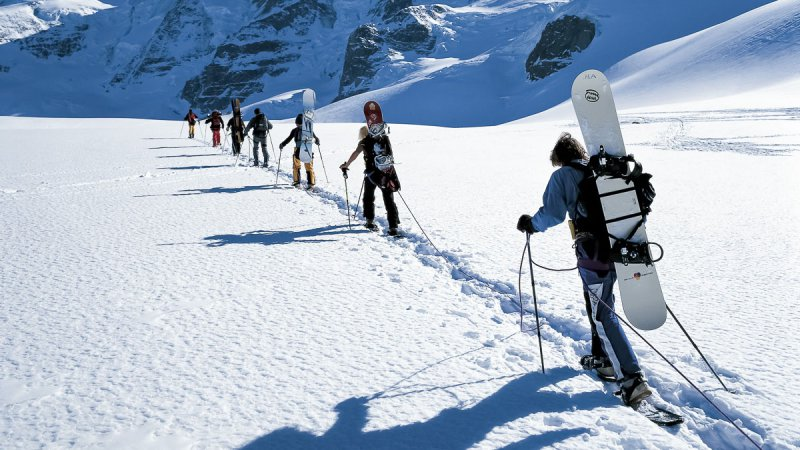 Bernina region in the Upper Engadine, Canton Graubuenden. Snowshoe and  snowboard tour leading up to the Piz Palü (in the