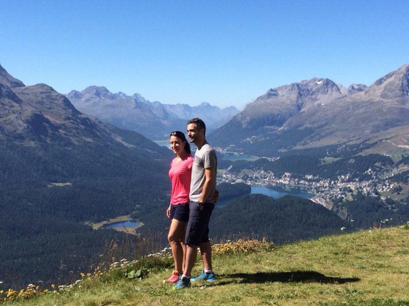 Hiking on Muottas Muragl in summer with view on Stazersee, St. Moritz, Lake Silvaplana in the back Piz Julier